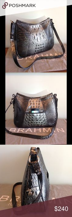 """Brahmin Gracie Shoulder Bag in Twilight ( RARE ) NWOT   Gorgeous Brahmin Gracie with beautiful Croc pattern in the Unique rare color Twilight Black ! This Med. Size shoulder bag is stunning ! This color sold out in weeks ! Very unusual to see Brahmin hardware & medallion in silver plus an adjustable shoulder strap with 19.5 """" drop. Top zip with small pocket on back perfect for cell phone. Bag was on display at Clothing Boutique but is in Brand NEW condition. Zip jewelry & zip wall pocket…"""