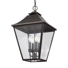 The Galena Collection is a Europe-inspired classic lantern. Simple and refined, Galena features a gently curved hook detail atop a vented, square-off roofline, and candle tubes floating within the tapered Clear Seeded glass shades. Galena is a warm, Outdoor Hanging Lanterns, Outdoor Ceiling Fans, Outdoor Wall Lantern, Outdoor Walls, Outdoor Lighting, Exterior Lighting, Classic Lanterns, Candelabra Bulbs, Candle Chandelier