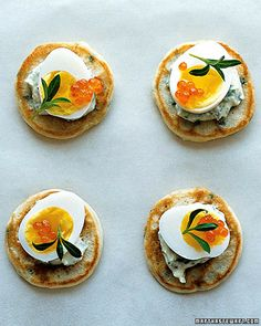 Chive Blini with Creme Fraiche, Quail Eggs, and Tarragon Bite-size blini are topped with a dollop of rich creme fraiche, diminutive quail eggs, and brilliant trout roe. One Bite Appetizers, Appetizer Recipes, Appetizer Ideas, Shower Appetizers, Elegant Appetizers, Party Appetizers, Party Snacks, Brunch Recipes, Burger Bar
