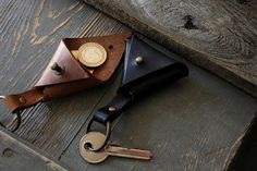 This leather key chain is perfect for keeping your keys organized in stylish way! Its also like a small coin holder, you can put inside the key chain few coins, that we will be always with you, or something else. Its perfect for every day use!! Each triangle key chain is made from good quality leather. Its 100% handmade product! ******* Leather key ring details: 2.3mm thick leather color black/ brown Total lenght with metal ring ring 9.5cm / 3.7inch Our handmade leather key cha...