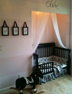 Put crib into closet to give you more space in the room, also gives the crib a nice frame.