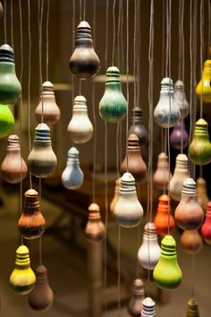 Red, you light up my life! Painted light bulbs hanging from fishing wire makes activates the space in a window display. Deco Cafe, Vitrine Design, Painted Light Bulbs, Decoration Vitrine, Church Stage Design, Visual Display, Store Displays, Retail Displays, Retail Design