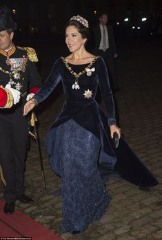 Wearing a midnight blue velvet floor-length gown with the bottom half embellished with delicate sequins, Crown Princess Mary looked elegant as she made her entrance at Amalienborg Palace in Copenhagen