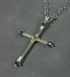 Handmade Sterling Silver Wire Wrapped Cross by MystikCritterZ