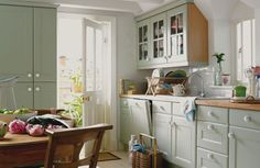Not your typical plain white country kitchen. Love the hidden dishwasher.