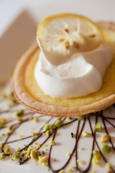 A dessert worth saving room for. Lemon Tart with Pistachios and Whipped Cream.