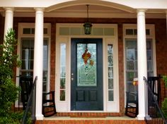 Exterior Exterior Front Door Designs for A Perfect Outer Look: Fallen Maple Leaves Exterior Front Door Design Idea With Dark Blue Glossy Finish Single Door Plus Cutting Glass Center Ornament Besides Varnished Brick Wall