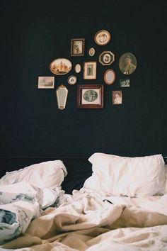 little gallery. dark walls. bedroom.