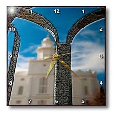 The Rod Iron Fence Texturized in Focus with The LDS Temple in Southern Utah Unfocused In The Back Wall Clock