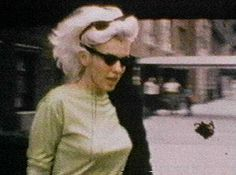 Marilyn. I love it when she wears zero makeup, hair doing whatever it wants, and her Cat Eye Sunglasses. Beautiful! 1962, New York, 57th St. M