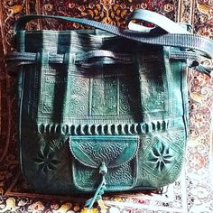 The tote craftsmanship is inspired by the ancient culture of Morocco. The hand embossing consists of geometrical Moroccan Architecture symbols and culture folk.