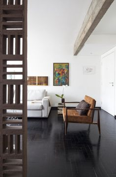 Living Room by Filipe Ramos Design  Apartment situated at Itaim Bibi neighbourhood in São Paulo, Brazil.