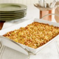 Squash Casserole with squash, zucchini, carrots, stuffing mix and cheese baked in a creamy sauce