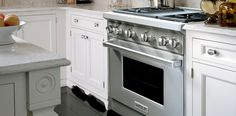 This the the Wolf (Sub Zero same family) stove/oven - handsome! But it does not have a warming drawer.