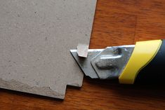 Slicing off edges to fit fabric and paper. http://feltandhoney.com/2013/04/12/ikea-latt-childrens-table-chairs-hack/