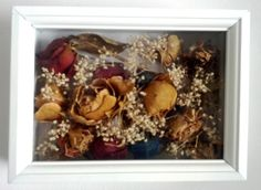 Instead of displaying dried flowers in a boring vase, I put them into a shadowbox. These particular flowers are from the first Valentines we had together.