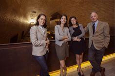 Albiera, Alessia and Allegra Antinori with Piero Antinori above barriques in the new cantina nel Chianti Classico.     pic by Mauro Puccini