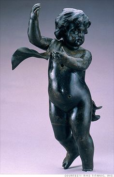 The bronze cherub is believed to have decorated the upper landing of the grand staircase in first class because it is smaller than the cheru...