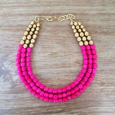 Dress up your Valentine's Day look with a pink and gold statement necklace.