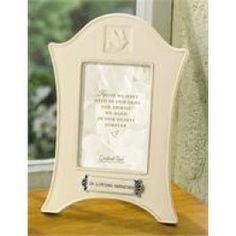 "A beautiful remembrance of a loved one, this picture frame can be placed in a special place in your home as a loving tribute. The frame says, ""In Loving Memory"" and the verse says...""Those we have held in our arms for awhile, we hold in hearts forever."""
