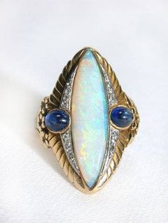 Egyptian Revival Deco Opal & sapphire ring. In November 1922 Howard Carter discovered the tomb of the boy King Tutankhamun.