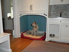 Custom cabinetry & finishing — two dog beds in the mudroom. One one either side of the sink.