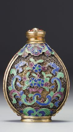 AN IMPERIAL ENAMELLED AND EMBELLISHED SILVER 'FLORAL SCROLLS' SNUFF BOTTLE QING DYNASTY, QIANLONG / JIAQING PERIOD