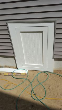 An Insulated Crawlspace Door With A Lock North Georgia