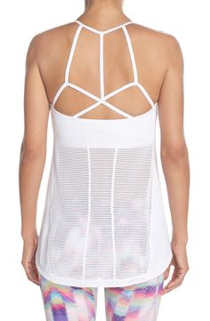 This sporty-chic workout tank from Zella has a snug, flattering fit and features strappy detailing, a built-in bra and a mesh back. Too cute!