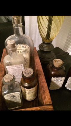 Beautiful Apothecarry Snake Oil style bottles in handmade medical drawer. The bottles are vintage and the labels on them are created by Angry Wood Design and then distressed to give them the antique look.   Check out all of our other cool pieces on our Angry Wood Design page on Facebook at https://www.facebook.com/angrywooddesign/