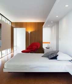 Floating ceiling above bed