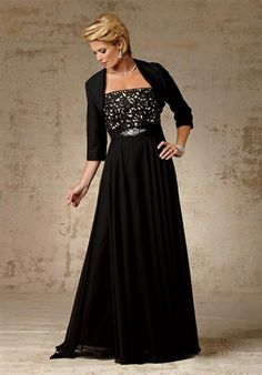 Dress features beading, lace, and matching jacket. Also available in petite sizes.