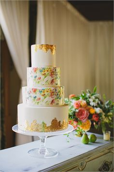 colorful floral and gold wedding cake