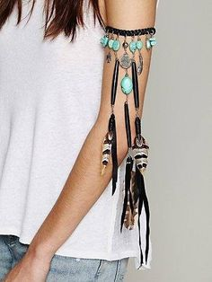 hippy style, arm band with leather and feathers