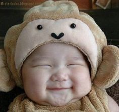cute Asian baby in a monkey costume :) I love his chubby cheeks!