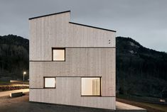 lukas mähr and carmen wurz of MWarchitekten have built a semi-detached house on a hillside in vorarlberg, austria, which comprises two entities of 125 sqm. Semi Detached, Detached House, La Shed Architecture, Roof Shapes, Real Estate Prices, Timber Cladding, Timber House, Wood Siding, Facade Design