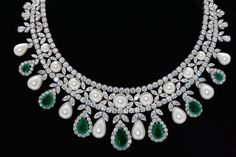 #DiosabyDarshanDave's statement jewels showcase artistic design and meticulous attention to detail. This feminine necklace features a #classic mix of #SwarovskiZirconia cuts, white Korean pearls and green stylized stones where each stone skillfully positioned resulting in a truly eye-catching jewellery piece. Perfect for #bridalwear and #destinationweddings! Available at #JewelleryArabiaShow, Bahrain from 24th to 28th November at #boothC14 in Palm Hall