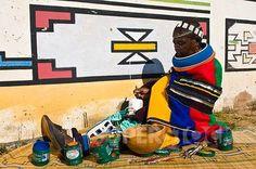Africa | Artist Francina Ndimande painting the walls of her house.  Mabhoko Village, KwaNedbele, Mpumalanga Provice, South Africa | ©Photononstop