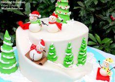 Sledding Snowman Cake! An adorable cake design for Christmas or winter. Tutorial by MyCakeSchool.com!