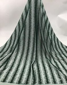 We offer a variety of fashion handmade fabric,those are widely use for wedding dress,garment and fashion cloth. Length : 5yards width is 130cm/51 inch Material : mesh ,Rayon,polyester. Symmetrical embroidery floral pattern, with lovely flowers in the middle, scalloped border. You can also cut Wine Colored Wedding, Colored Wedding Dresses, Beaded Lace Fabric, Fashion Beads, Purple Fashion, Green Lace, Fabric Shop, Dress Tops, Floral Embroidery