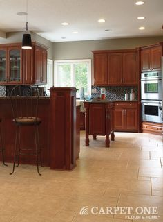 Tile is great for kitchens as it resists spills. Tile from Carpet One Floor & Home