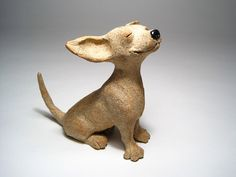 Chihuahua Dog Sculpture. Happiness is a cool breeze. Nose up, ears flapping in the air, this little Chihuahua is soaking up the smells and enjoying life to the fullest. You cant look at him and not smile. I dare you. This Chi is one of my Bliss dogs, which have been very popular. They are entirely hand-sculpted out of hire-fire stoneware clay, and are unique, one-of-a-kind pieces. They are fired twice, with just touches of glaze, and have a sandy, stone-like surface, with natural color…