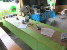 activity table for the kids - lots of eco-superhero / recyclable coloring pages and a few Earth Day games/activities from Oriental trading