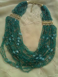 Teal and Gold Seed Beaded multi strand necklace.
