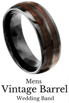 Mens wedding rings! This unique mens wood wedding band is made out of black high tech ceramic and genuine koa wood. This ring is 100% waterproof and extremely durable!