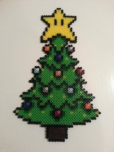 Copied a neat tree I saw here a few weeks ago. Added some lights and different color ornaments. - Imgur