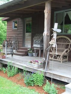 I love the bench and birdhouse, everything about this porch!