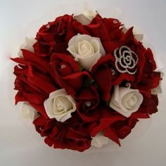 Romantic mixture of red roses with a single rose brooch finished with crystal pins