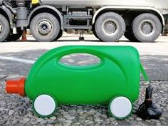 Martine Camillieri is a visual artist and author - a pioneer in recycling everyday items into toys, in this case recycled bottles become toy automobiles. Recycled Toys, Recycled Bottles, Plastic Bottles, Recycled Materials, Empty Bottles, Plastic Containers, Craft Projects For Kids, Diy For Kids, Crafts To Make