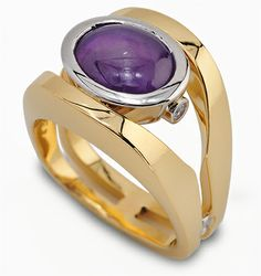 Paragon Collection  122-G09   8.05 ct Purple Star Sapphire set in 18K Yellow Gold and Platinum.